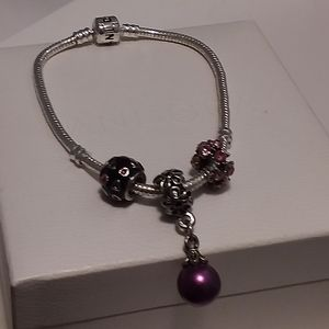 Pandora sterling silver bracelet with three charms